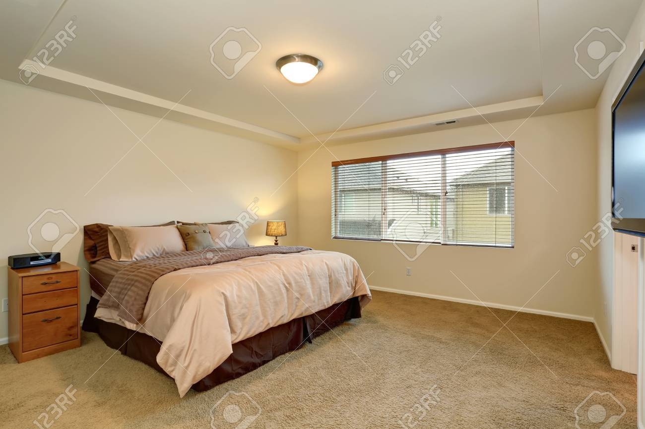 Simple Master Bedroom With Tv And Tan Bedding Stock Photo Picture And Royalty Free Image Image 43962941