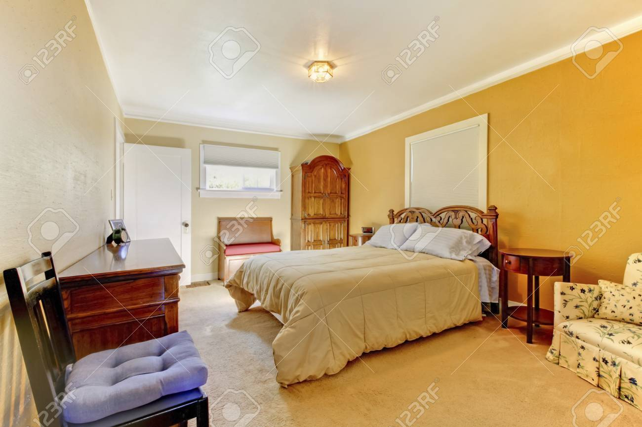 Nice Yellow Bedroom Interior With Carved Wood Bed Nightstand Stock Photo Picture And Royalty Free Image Image 58329120