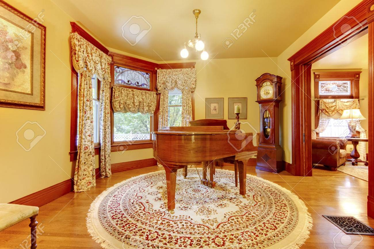 Beau Adorable Vintage Wood Piano In Luxurious Living Room Interior With Floral  Patterned Curtains, Carpet With