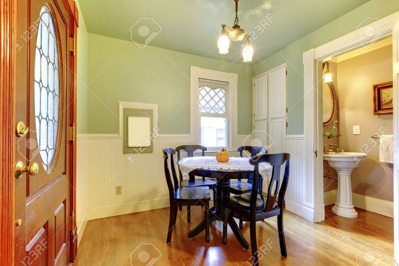 Small And Cozy Dining Room With Black Wood Table Chair Set And ...