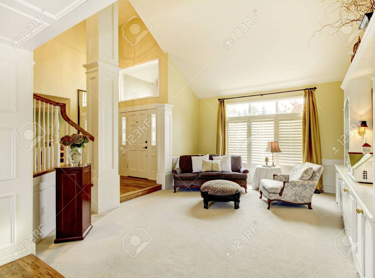 Luxury Home Well Decorated Golden Living Room With Beige Carpet