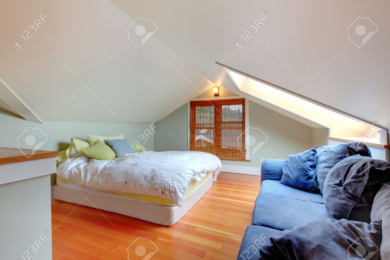 Small Bedroom In The Attic With Vaulted Ceiling And Hardwood Floor Stock P O 58757401