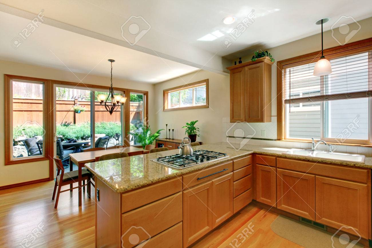 Brown And White Kitchen Room With Hardwood Floor Cabinets Granite Stock Photo Picture And Royalty Free Image Image 58757472