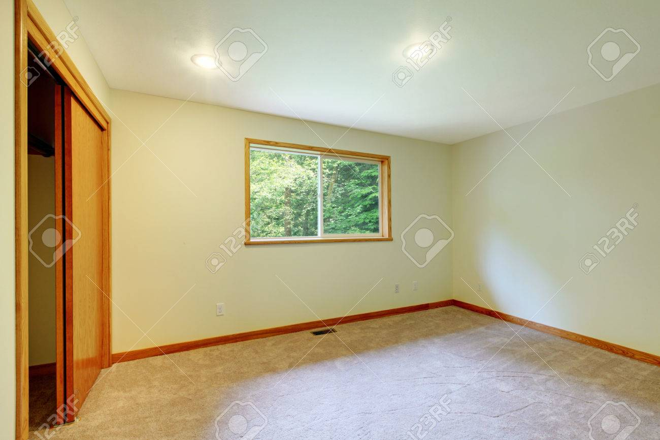 Interior Of Small Empty Bedroom With Closet Soft Beige Carpet