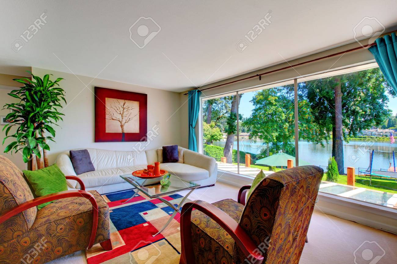 Classic red and blue living room interior with comfortable furniture..