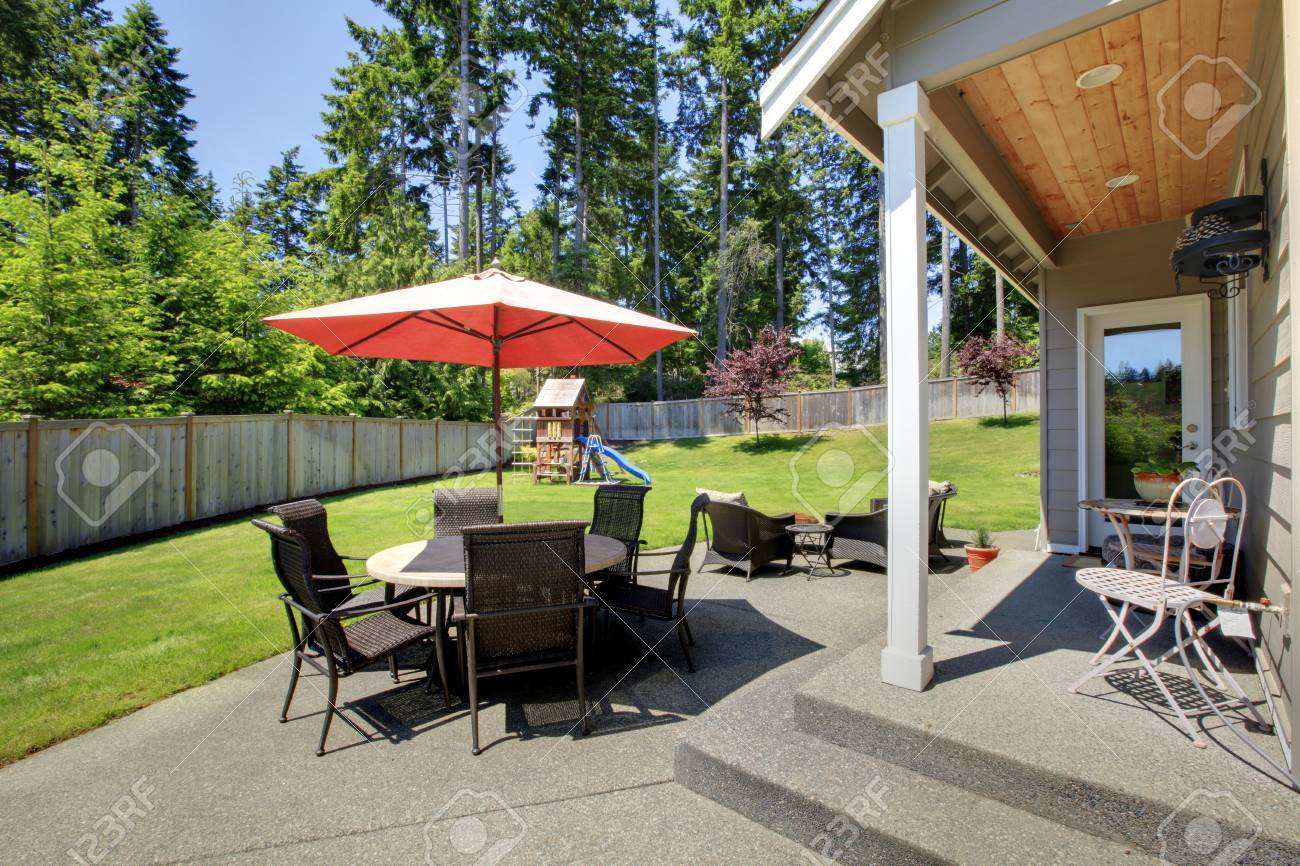 Admirable Fenced Backyard Area With Patio Table Umbrella And Chairs And Machost Co Dining Chair Design Ideas Machostcouk