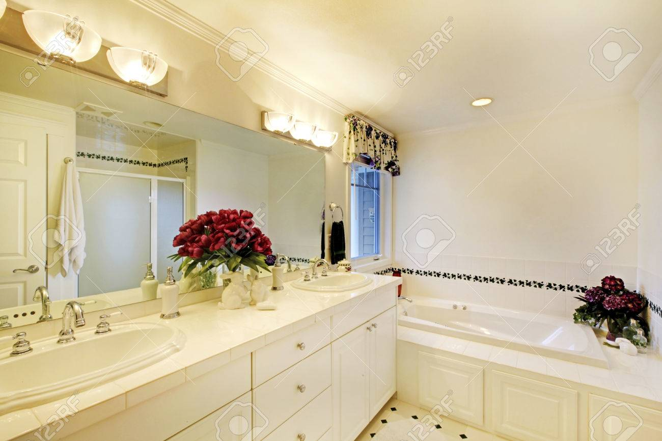 Elegant White Bathroom Interior With Two Sinks And Large Mirror ...