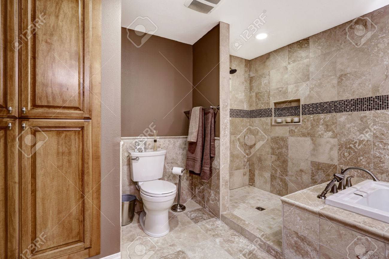 Empty Bathroom Interior. Light Brown Tile, Bath Tub, Shower And ...