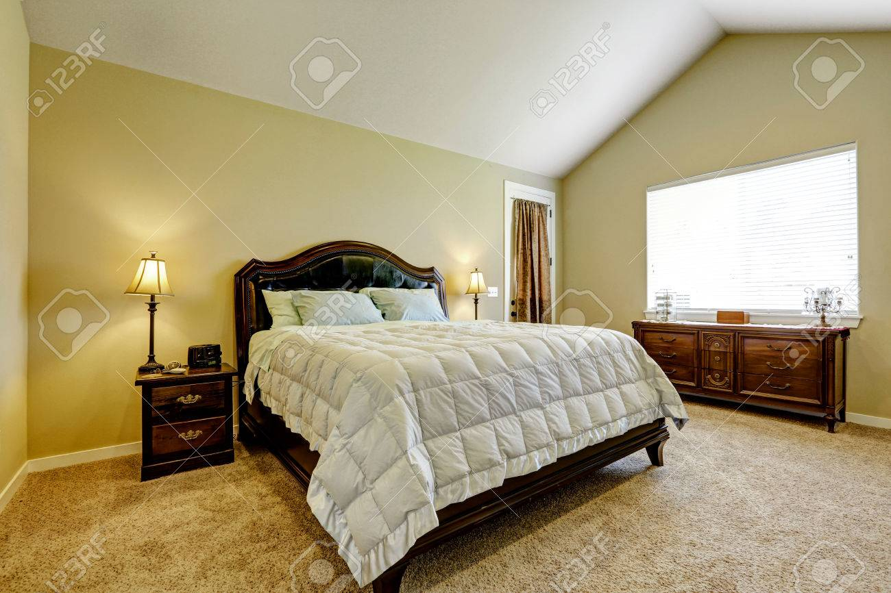 Master Bedroom With Deep Brown Furniture Set And Vaulted Ceiling Stock Photo Picture And Royalty Free Image Image 59952812