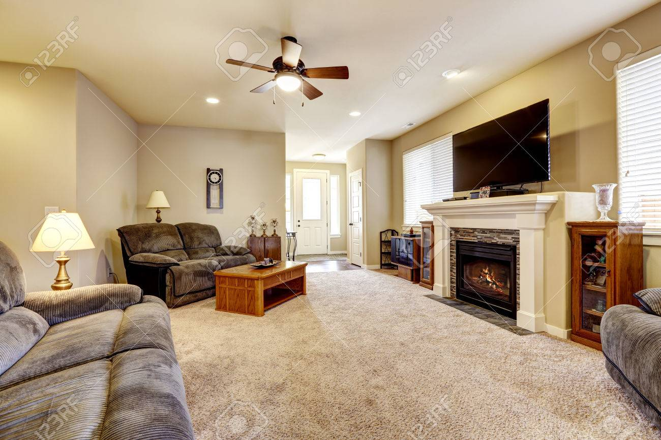 Living room interior in classic American style with beige walls,..