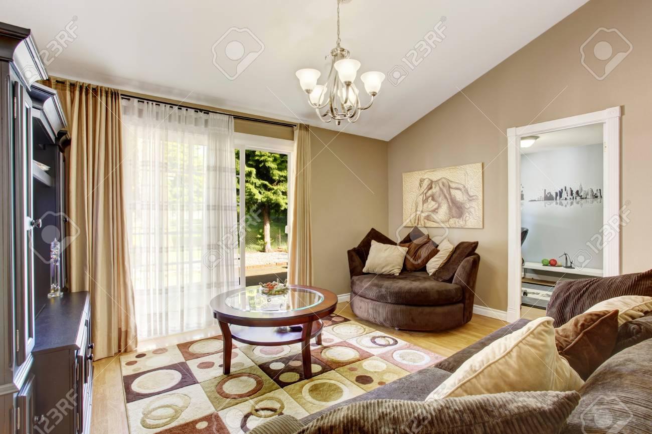 American Family Room With Brown Sofa Set Rug Glass Top Coffee