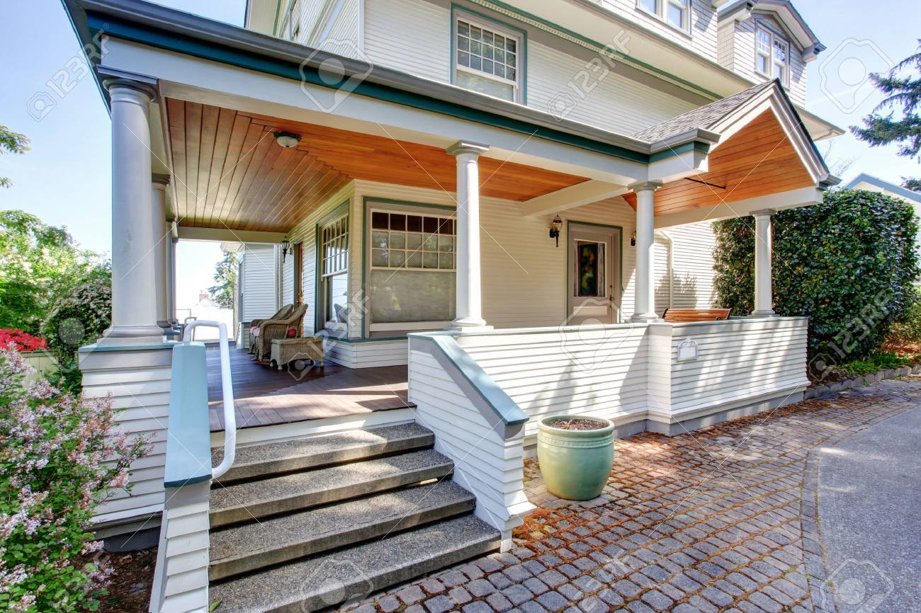 Front Porch With Chairs And Columns Of Craftsman Style Home Stock