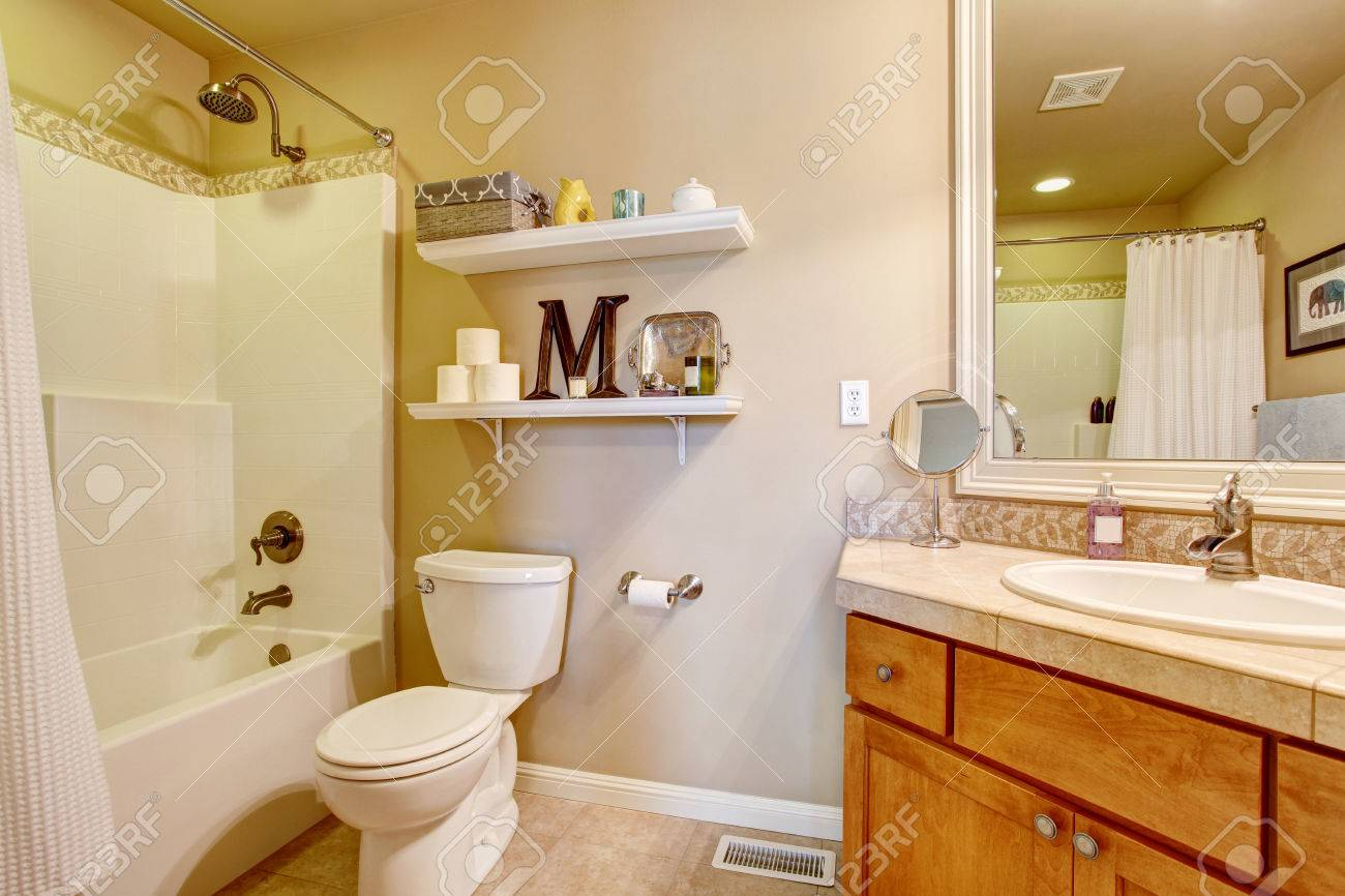Cozy Antique Bathroom Interior In White Tones With Shelves On ...