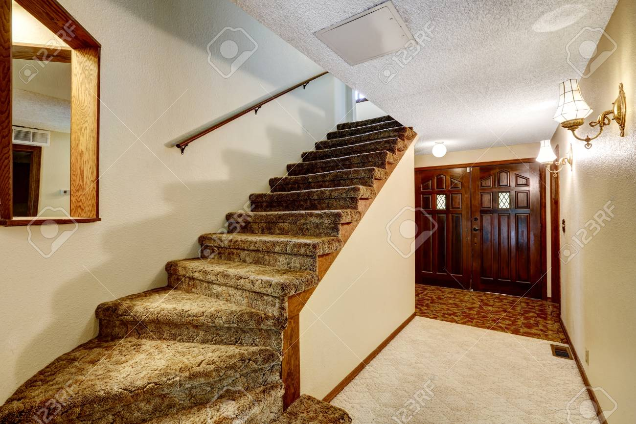 Hallway Interior With Carpet Stairs View And Wooden Enterance Door Stock  Photo   59955465