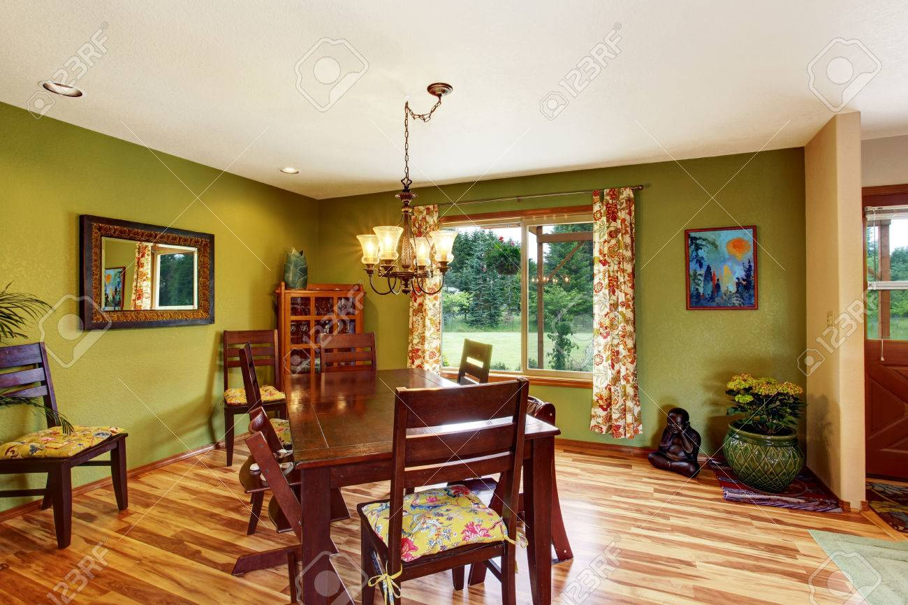 Antique Green Dining Room Interior With Mahogany Table Set And Chandelier Hardwood Floor White