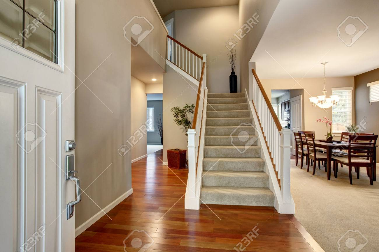 Light Entryway With View Of Staircase Hallway And Dining Room Interior Is Decorated