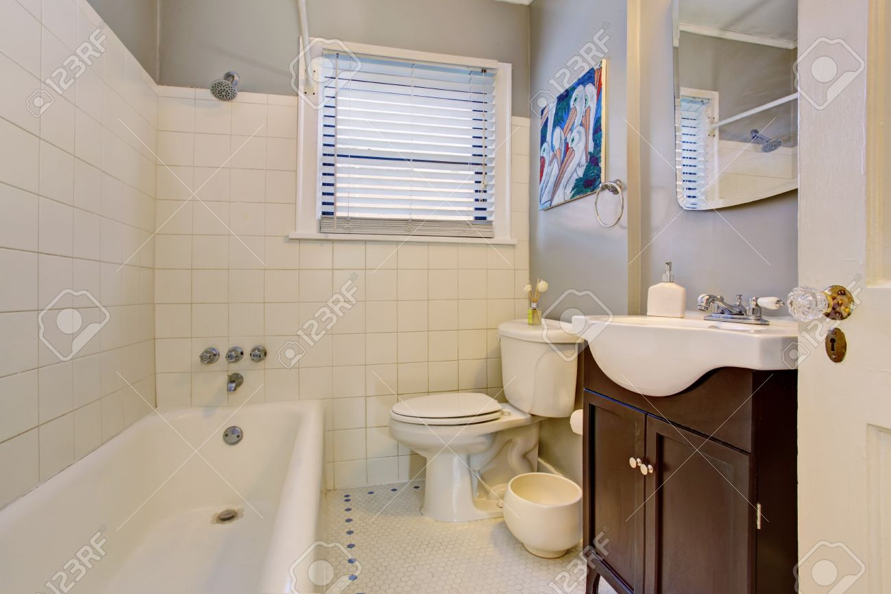 Grey Antique Elegant Bathroom With White Tub, Dark Brown Cabinet ...