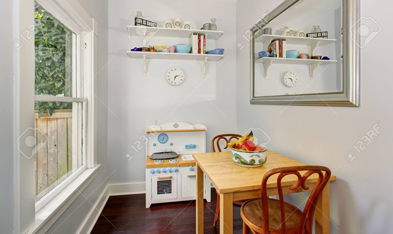 cozy kids furniture. Small Cute Furniture In Cozy Kids Playroom With White Walls And One Window. Stock Photo
