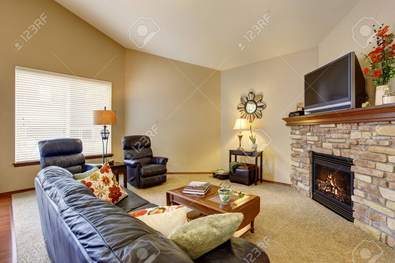 Cozy And Comforatable Living Room Interior With Deep Blue Leather