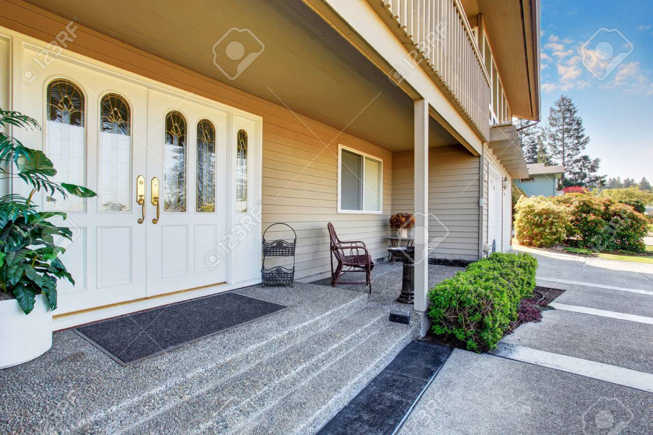 Spacious Entrance Porch With White Double Front Doors Of Luxury ...