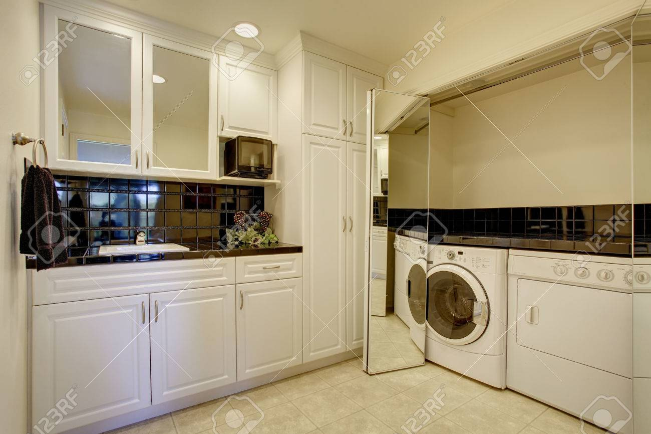 Small Kitchen Room With White Cabinets And Black Back Splash Stock Photo Picture And Royalty Free Image Image 59956495