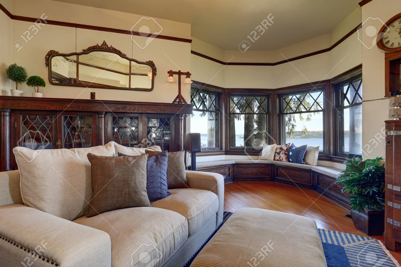 vintage style living room furniture. Stock Photo - Vintage Style Living Room With Beige Sofa And Antique Wooden Cabinet. View Of Cozy Sitting Area. Furniture R