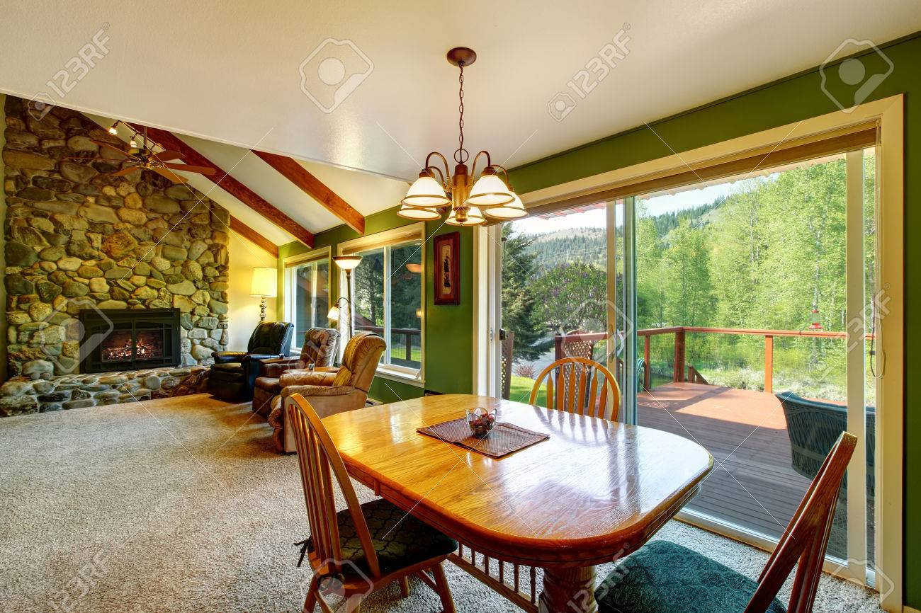 Great living room and dining interior in American country house...