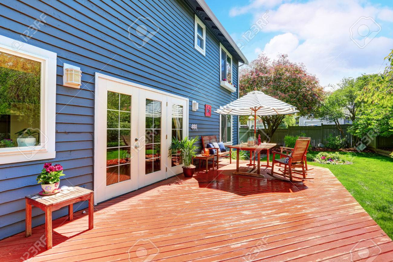 Wooden Walkout Deck In The Backyard Garden Of Blue Siding House Stock Photo Picture And Royalty Free Image Image 59957743