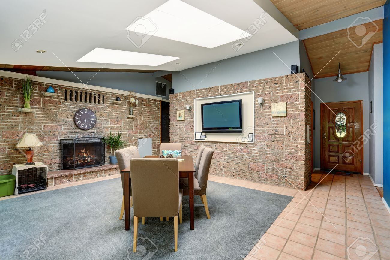 light spacious dining room with stone tile wall and built-in
