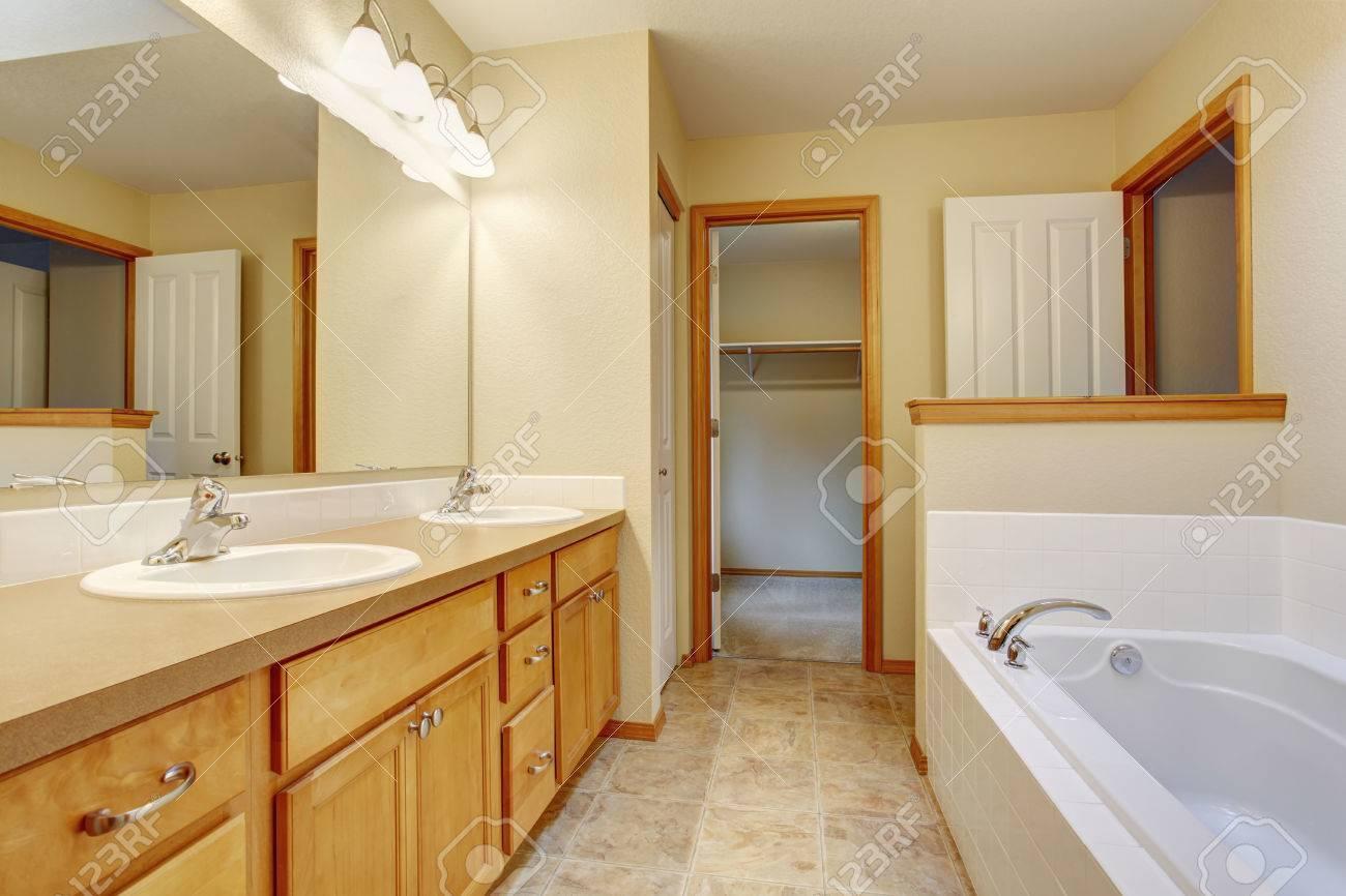 Bathroom Interior White Bath Tub, Toilet And Two Sinks. Brown ...