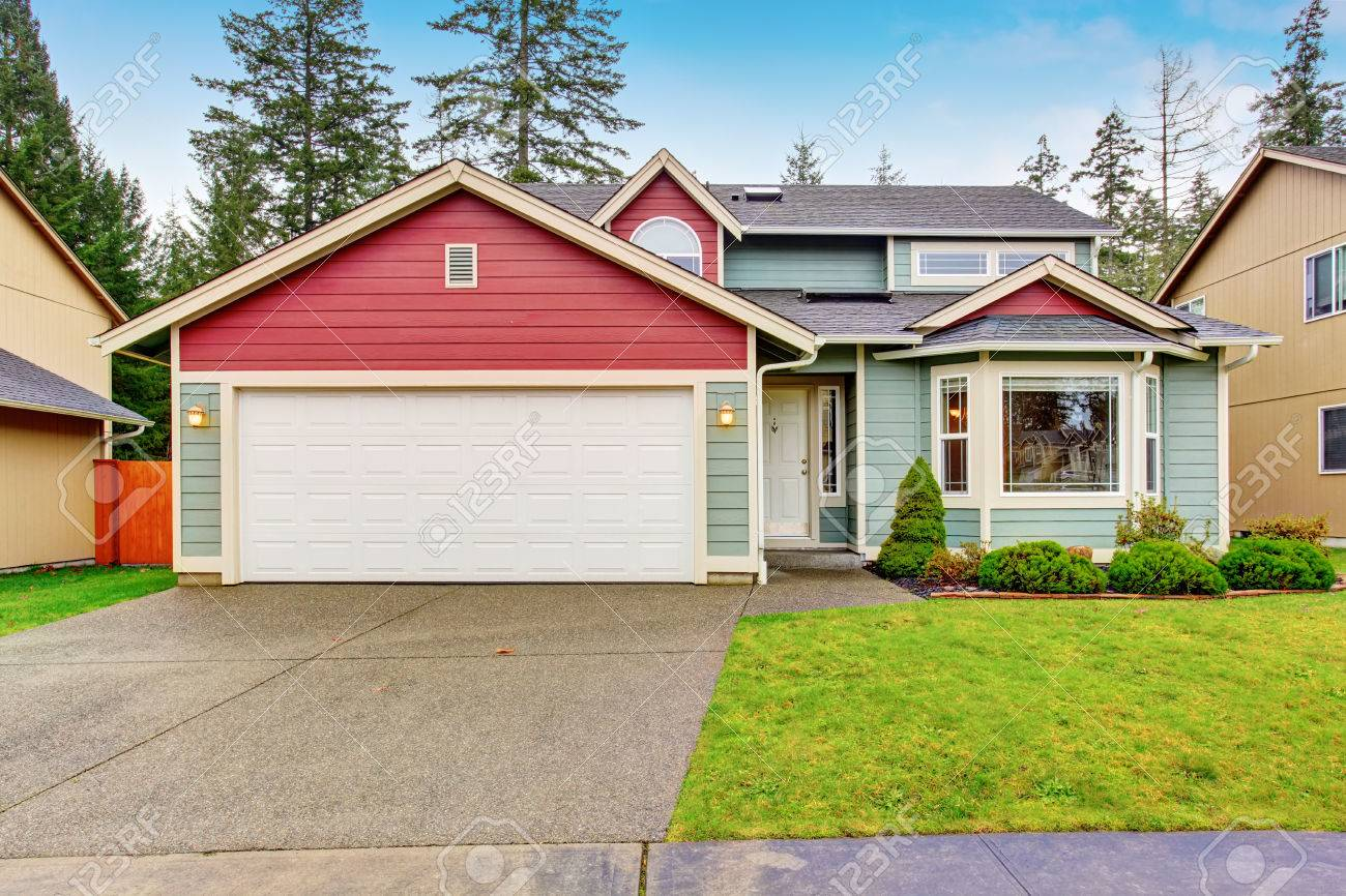 Classic American House With Red And Blue Trim Also Garage With