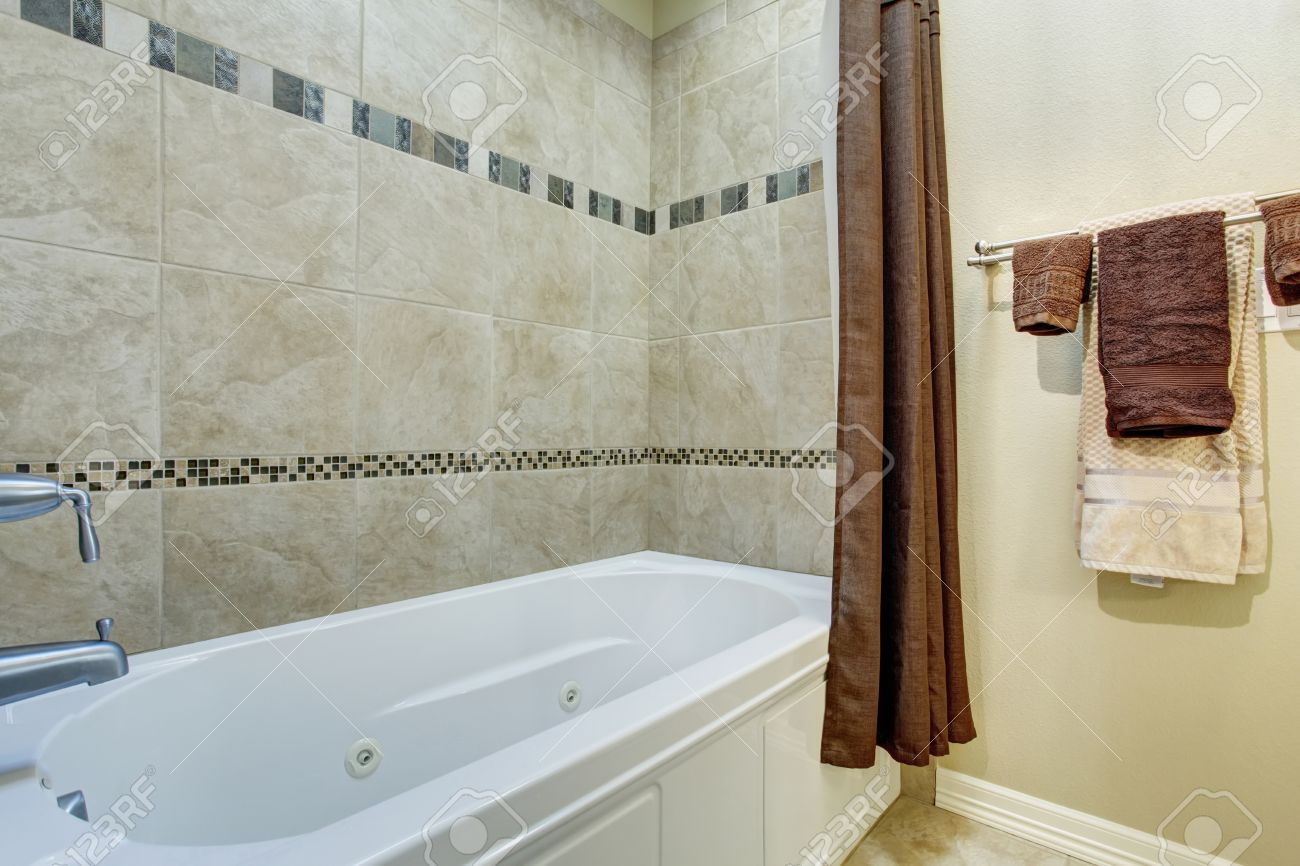 Bathroom Interior With White Shower Bath Tub And Deep Brown.. Stock ...