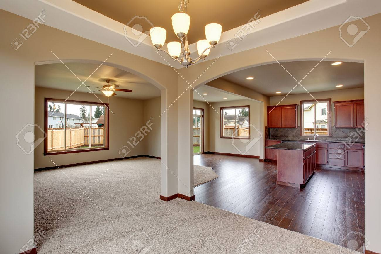 Superior Open Floor Plan Living Room Interior With Carpet Floor And Fireplace  Connected With Kitchen Stock Photo Nice Ideas