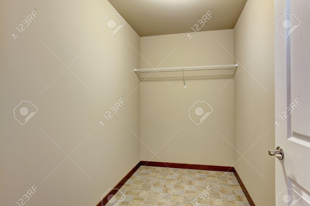 empty narrow walkin closet with shelves and tile floor stock photo 59996924 empty walk in69 closet