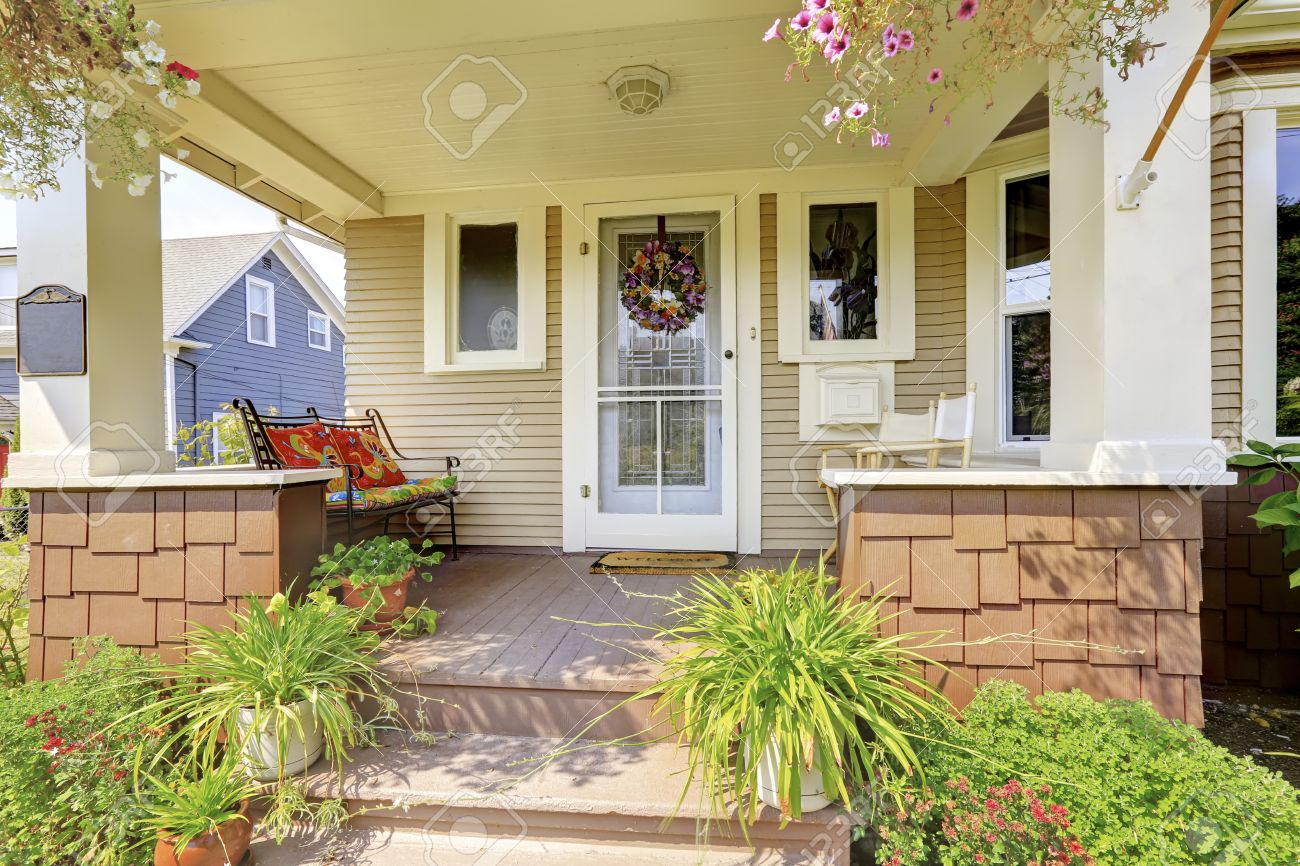Covered front porch craftsman style home royalty free stock image - American Craftsman House Exterior Cozy Covered Porch With White Columns And Lots Of Flowers In