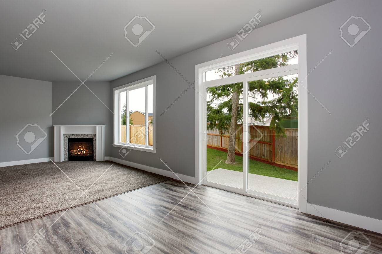 fireplace windows. Grey living room interior with fireplace  Windows and Glass doors overlooking the back yard Living Room Interior With Fireplace And Doors