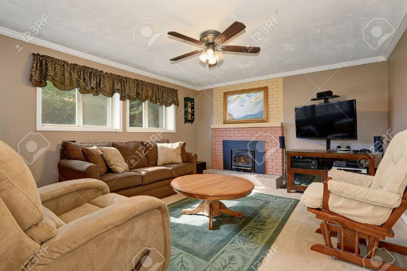 Typical American Living Room With Brown Couch Rocking Chair Stock Photo Picture And Royalty Free Image Image 60410611