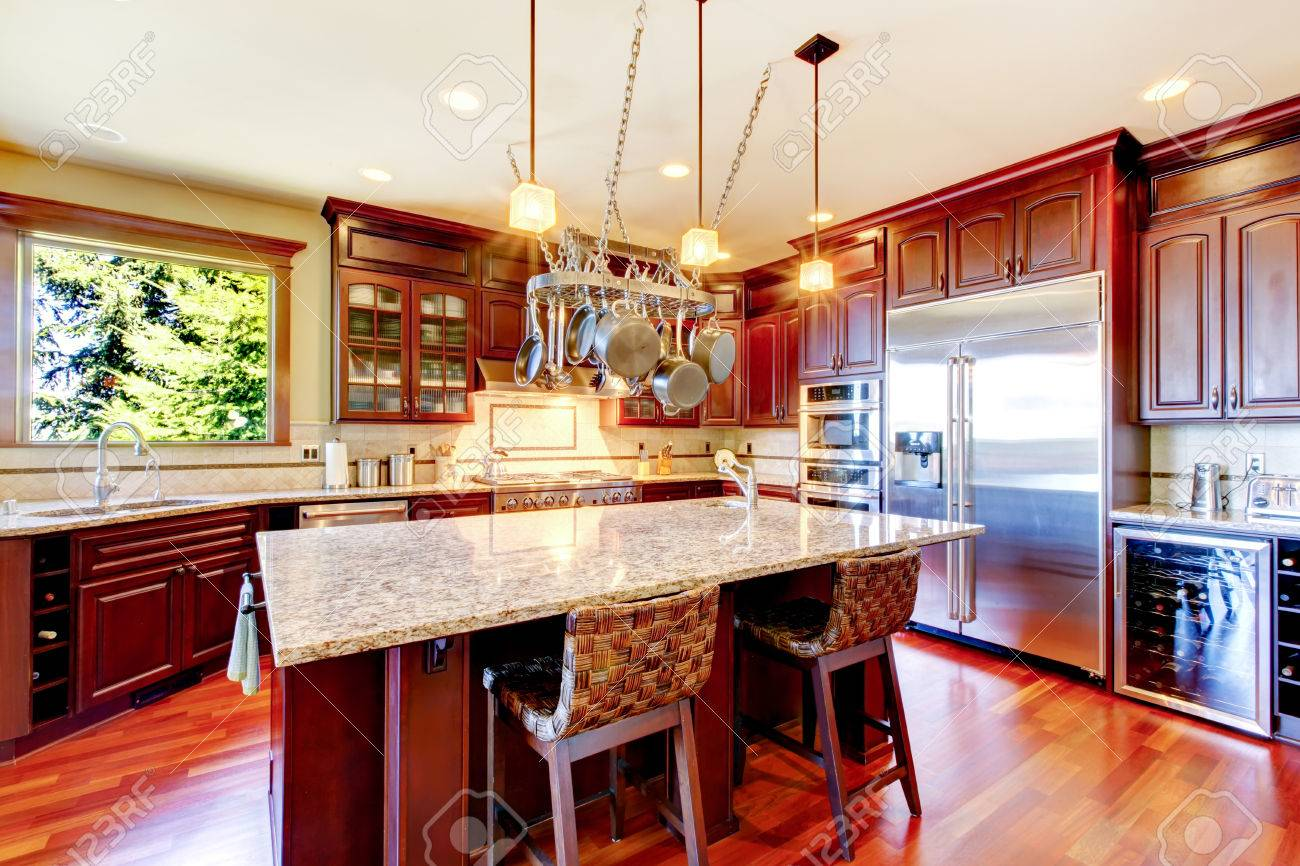 Luxury Modern Kitchen Room With Mahogany Storage Combination, Granite Tops,  Island And Hanging Pot