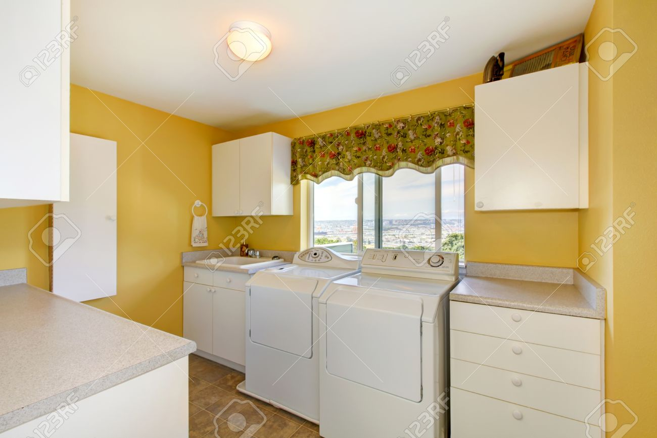 Old Laundry Room With White Cabinets And Yellow Walls. Northwest ...