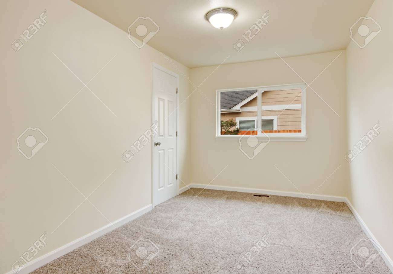 Small Empty Room In Warm Creamy Tones With Window And Carpet Stock Photo Picture And Royalty Free Image Image 61133508