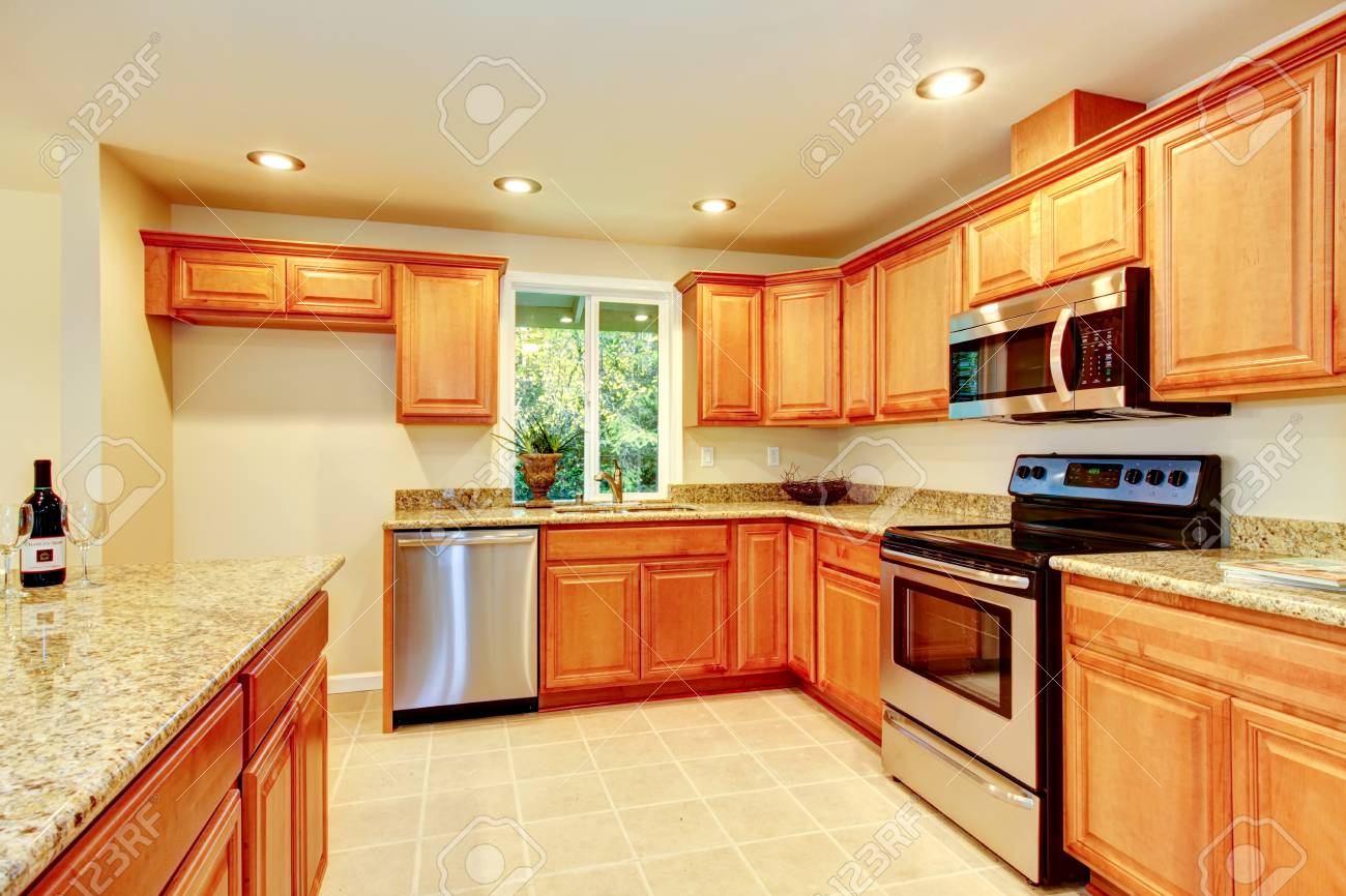 Bright Kitchen Room With Light Brown Cabinets With Granite Counter Stock Photo Picture And Royalty Free Image Image 61133509