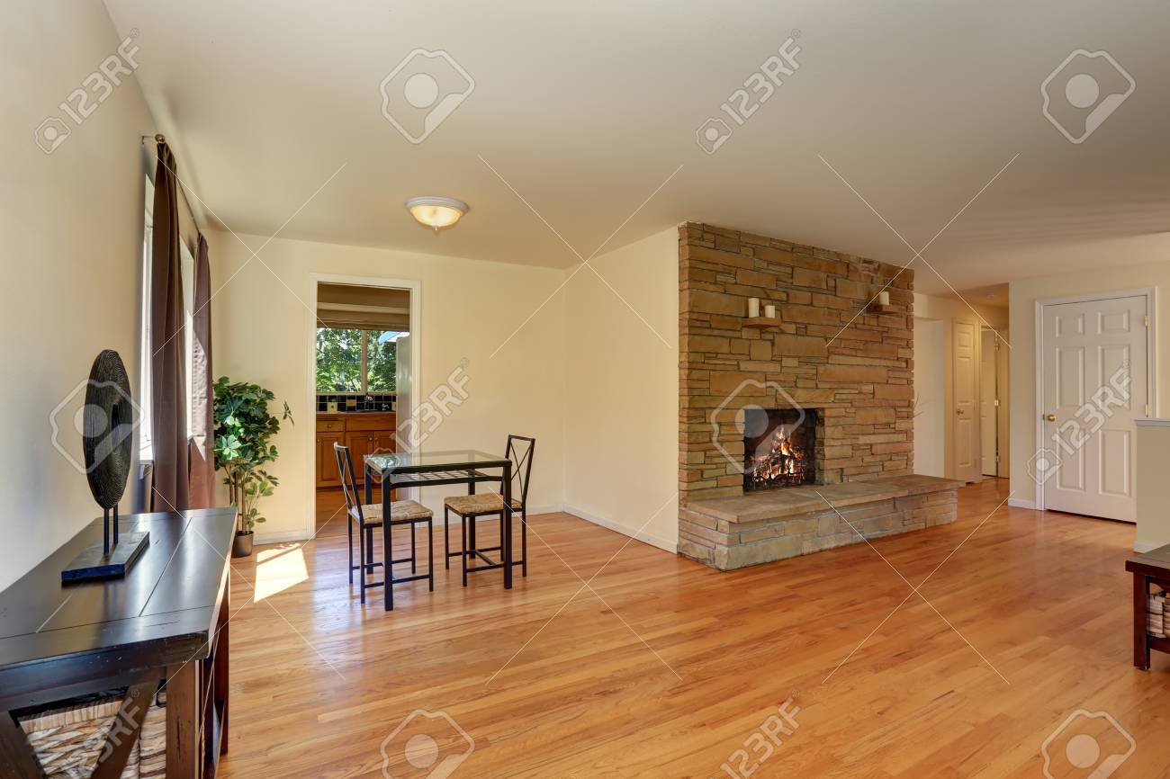 Nice Living Room In Blue And Brown Colors With Stone Tile Fireplace
