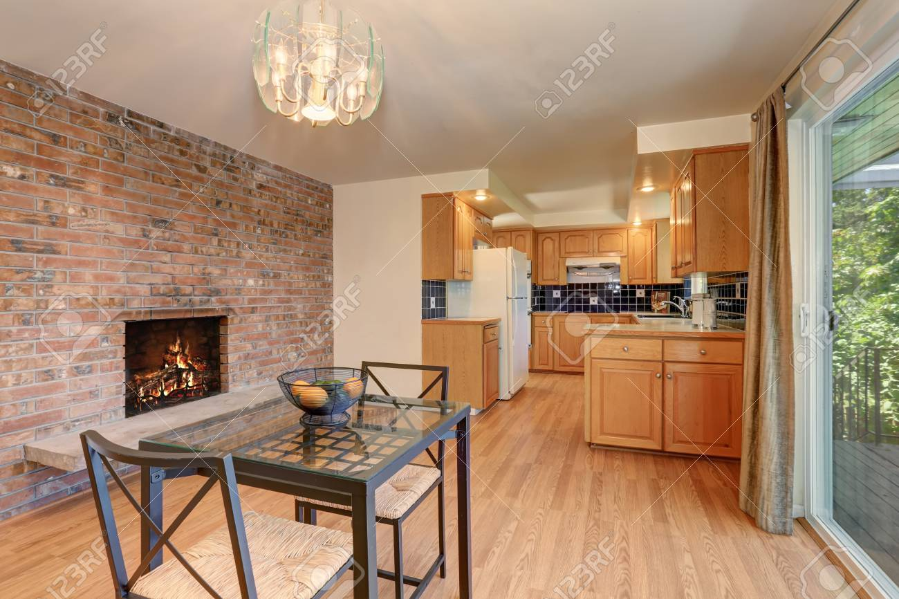 Nice dining room with hardwood floor and brick tile fireplace...