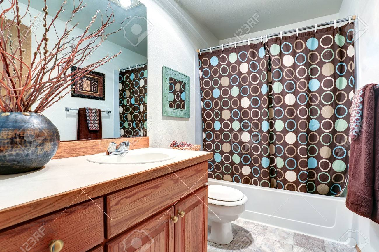 House Interior Bathroom Vanity Cabinet With Large Mirror Brown Shower Curtain And Decorative Vase