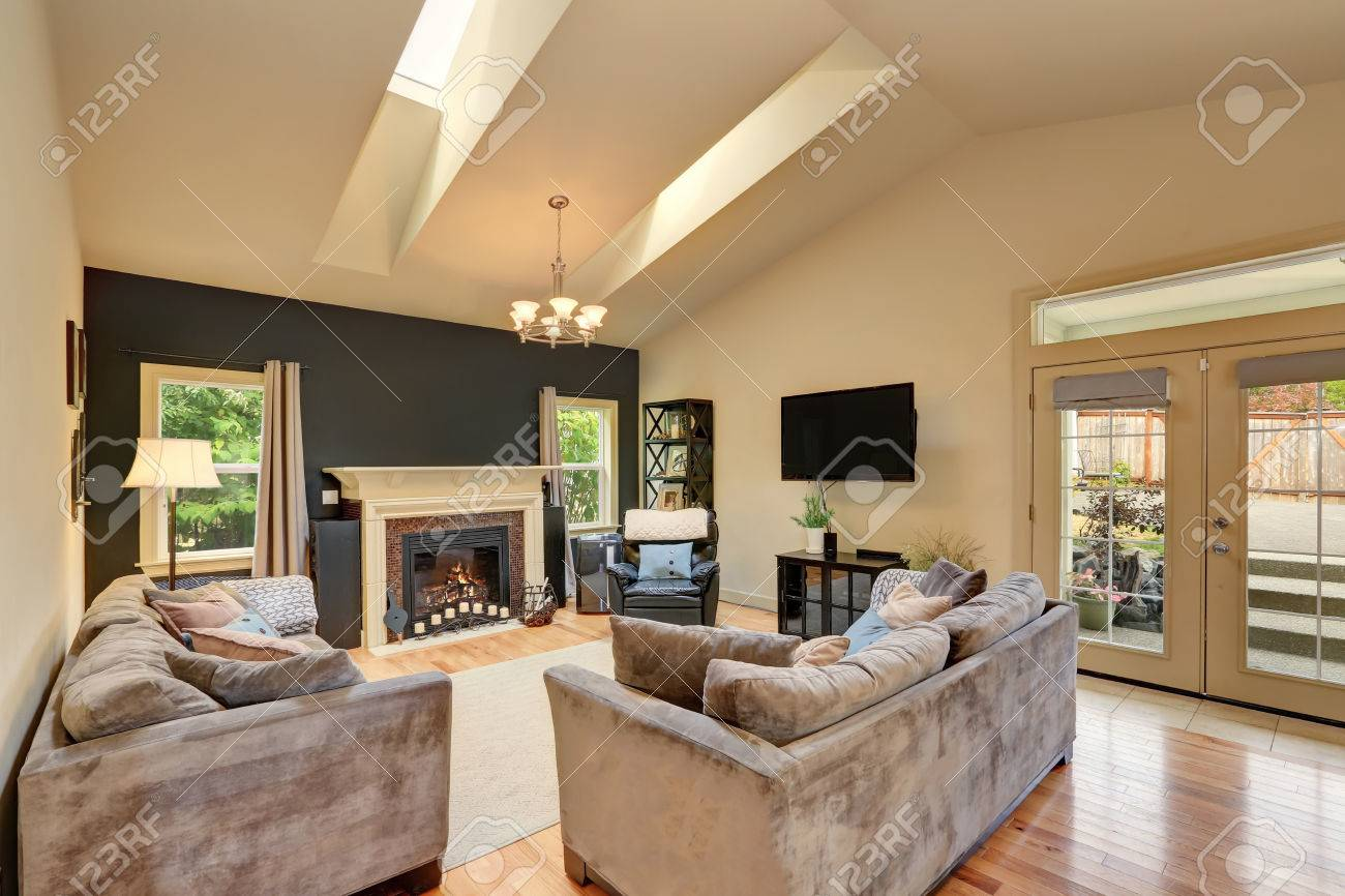 classic american family room with fireplace and sofas has vaulted