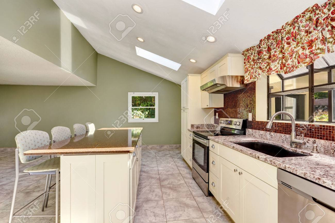 Bright Sunny Kitchen With Vaulted Ceiling And Skylights. Old Fashioned  Storage Combination, White Fridge
