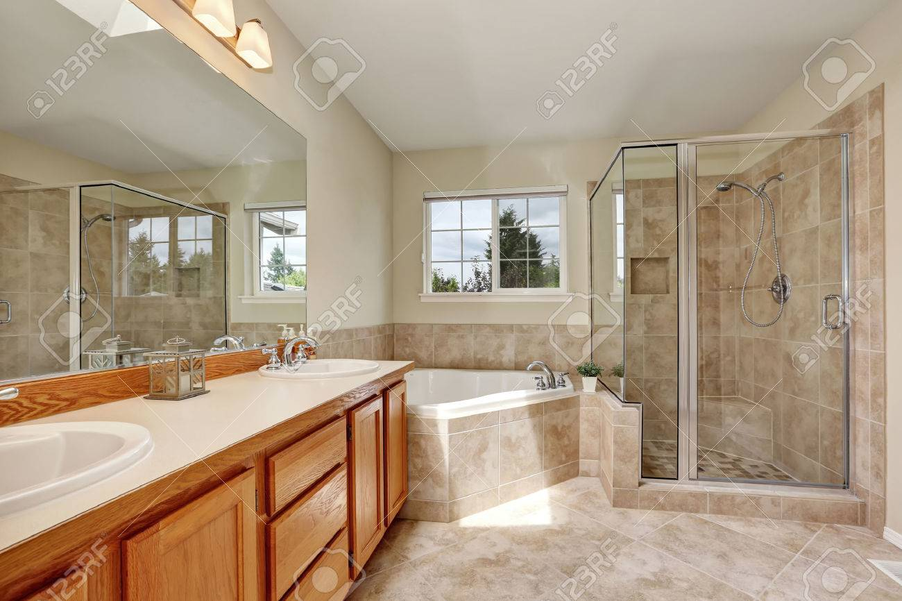 Master Bathroom With Corner Bathtub Skylight And Tile Flooring Stock Photo Picture And Royalty Free Image Image 61274853