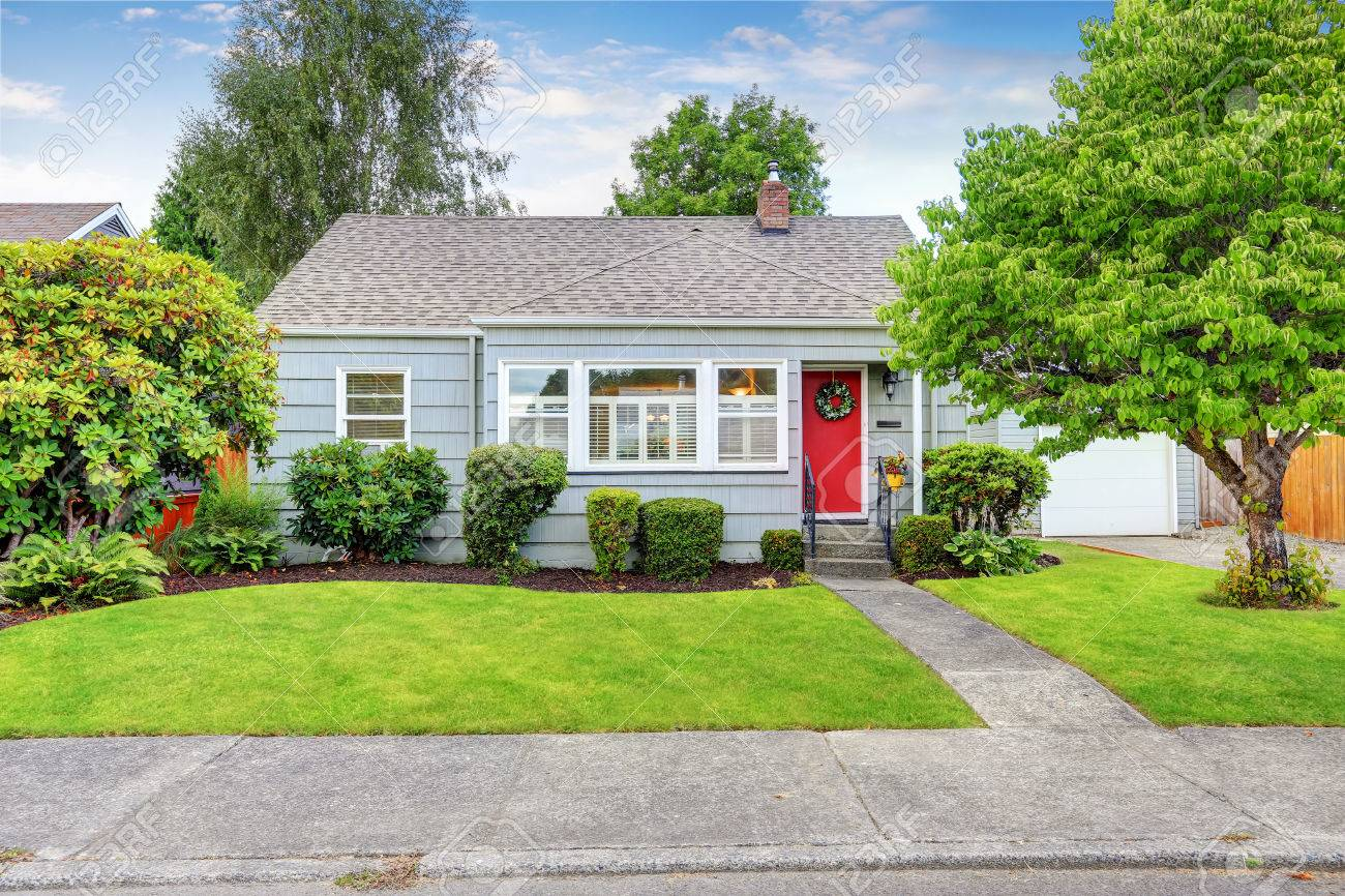 Delightful Exterior Of Small American House With Blue Paint And Red Entrance Door.  Northwest, USA