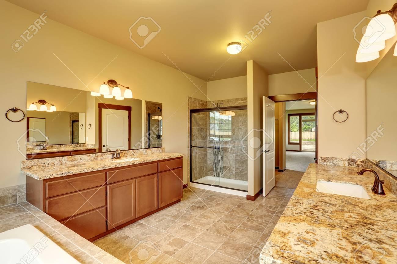 Luxury Bathroom Interior With Granite Trim And Two Vanity Cabinets.  Northwest, USA Stock Photo
