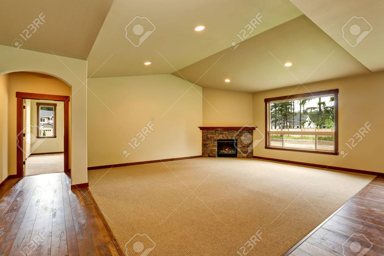 Empty living room with carpet - Empty Living Room With Fireplace And Carpet Floor Connected To